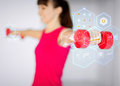 Sporty woman hands with light red dumbbells sport and recreation concept Stock Image