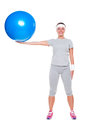 Sporty woman holding blue ball Stock Image