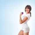 A sporty woman holding a dumbbell girl with dumbbells over blue background Stock Photos