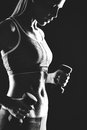 Sporty woman image of slim female in activewear doing exercise with dumbbells Royalty Free Stock Photography