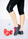 Sporty woman legs with light red dumbbells Royalty Free Stock Photography
