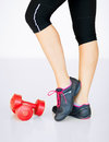 Sporty woman legs with light red dumbbells sport and recreation concept Stock Image