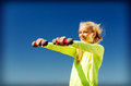 Sporty woman with light dumbbells outdoors sport and lifestyle young Royalty Free Stock Image