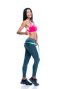 Sporty woman measure her buttocks with a measuring tape full length portrait of smiling and showing thumb up sign isolated on Stock Photo