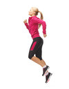 Sporty woman running or jumping picture of beautiful Royalty Free Stock Photo