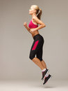 Sporty woman running or jumping picture of beautiful Stock Images