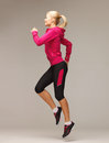Sporty woman running or jumping picture of beautiful Stock Image