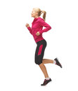 Sporty woman running or jumping picture of beautiful Royalty Free Stock Photos