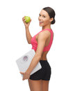 Sporty woman with scale and green apple picture of beautiful Royalty Free Stock Photos
