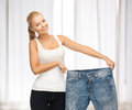 Sporty woman showing big pants Stock Image