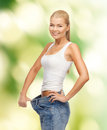 Sporty woman showing big pants Stock Photo