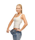Sporty woman showing big pants picture of Stock Image