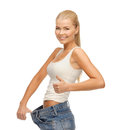 Sporty woman showing big pants picture of and thumbs up Stock Image