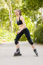 Sporty woman with skates in a park Royalty Free Stock Image