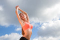 Sporty woman on the sky background Stock Images