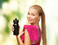 Sporty woman with special sportsman bottle Stock Images