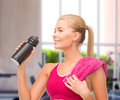Sporty woman with special sportsman bottle fitness and diet concept and towel Royalty Free Stock Photo