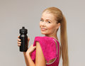Sporty woman with special sportsman bottle picture of Royalty Free Stock Photography