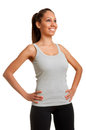 Sporty woman standing up with arms resting at her waist looking up isolated in white Royalty Free Stock Photography