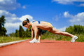 Sporty woman stretching Royalty Free Stock Images