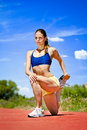 Sporty woman stretching quadriceps young Stock Images