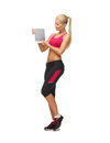 Sporty woman with tablet pc showing something on Royalty Free Stock Photos