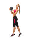 Sporty woman with tablet pc showing something on Royalty Free Stock Photo