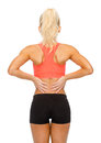 Sporty woman touching her back fitness healthcare and medicine concept Stock Photos
