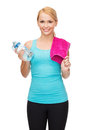 Sporty woman with towel and watel bottle Stock Photo