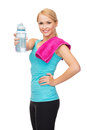 Sporty woman with towel and watel bottle Stock Photos
