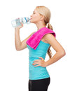 Sporty woman with towel and watel bottle sport excercise healthcare pink water Royalty Free Stock Photos