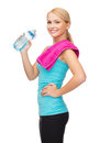Sporty woman with towel and watel bottle sport excercise healthcare pink water Stock Photo