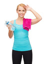 Sporty woman with towel and watel bottle sport excercise healthcare pink water Stock Images