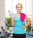 Sporty woman with towel and watel bottle sport excercise healthcare pink water Royalty Free Stock Photo
