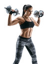 Sporty woman in training pumping up muscles of the back and hands with dumbbells. Royalty Free Stock Photo