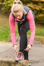 Sporty woman tying her shoes Royalty Free Stock Photo
