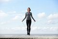 Sporty woman warming up with jump rope Royalty Free Stock Photo