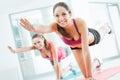 Sporty women doing pilates workout