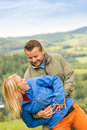 Sporty young couple hugging front scenic landscape Royalty Free Stock Image