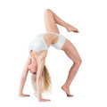 Sporty young girl doing gymnastic fit woman bridge isolated on white background Royalty Free Stock Photo