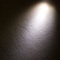 Spot light beam on wall Stock Images