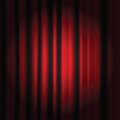 Spot light on a red curtain stage Stock Image