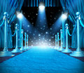 In the spotlight and center of attention or limelight with blue glowing lights on stage as a concept for entertainment with roped Royalty Free Stock Photos