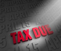 Spotlight on tax due date a illuminates bright red a dark background of april s Stock Photography