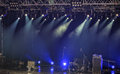Spotlights and illumination on stage with sound equipment drums amplifiers loudspeakers other Royalty Free Stock Photo