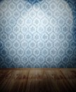 Spotlit wall wooden floor and wallpaper Royalty Free Stock Photography