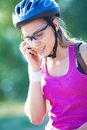 Spotry woman young sporty in helmet talking on the phone Royalty Free Stock Images