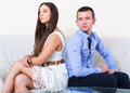 Spouses having bad argue angry young in livingroom at home Royalty Free Stock Photography