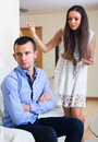 Spouses having bad argue sad young in livingroom at home Stock Image