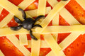 Sppoky cobweb closeup take of a tomato and cheese a halloween pizza Stock Image